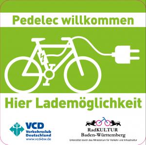 VCD-Aufkleber 'Pedelec willkommen. Hier Lademöglichkeit'.